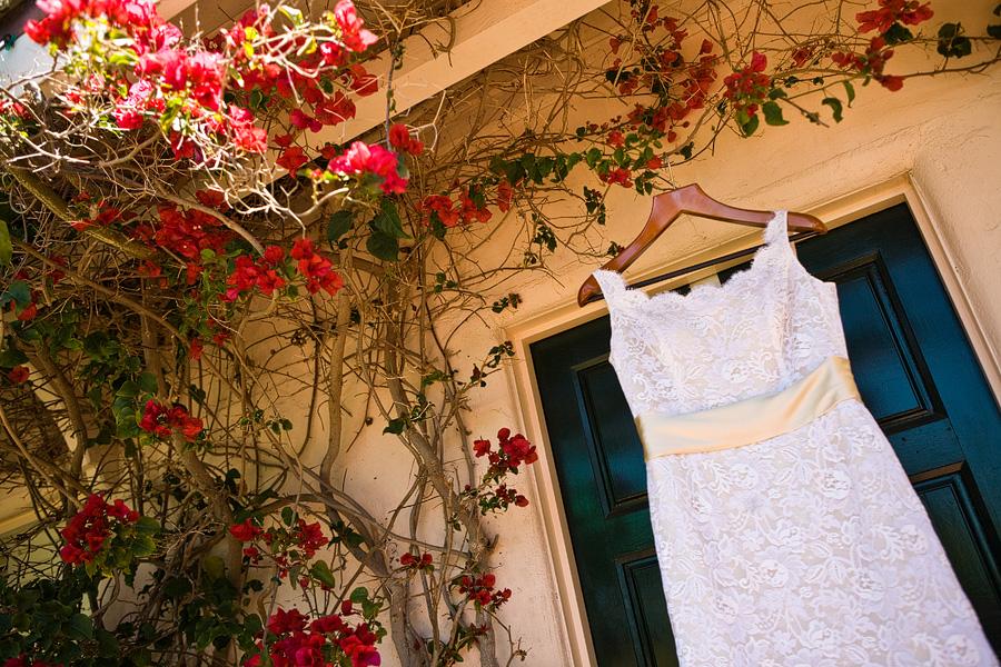wedding dress, wedding dress hanging at the La Playa Hotel bridal suite, La Playa Hotel bridal suite