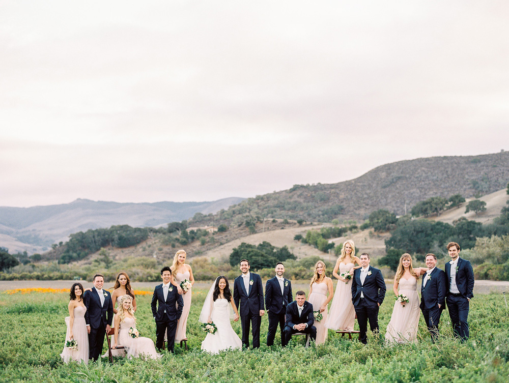 Large bridal party in the open field at Apple Creek Ranch