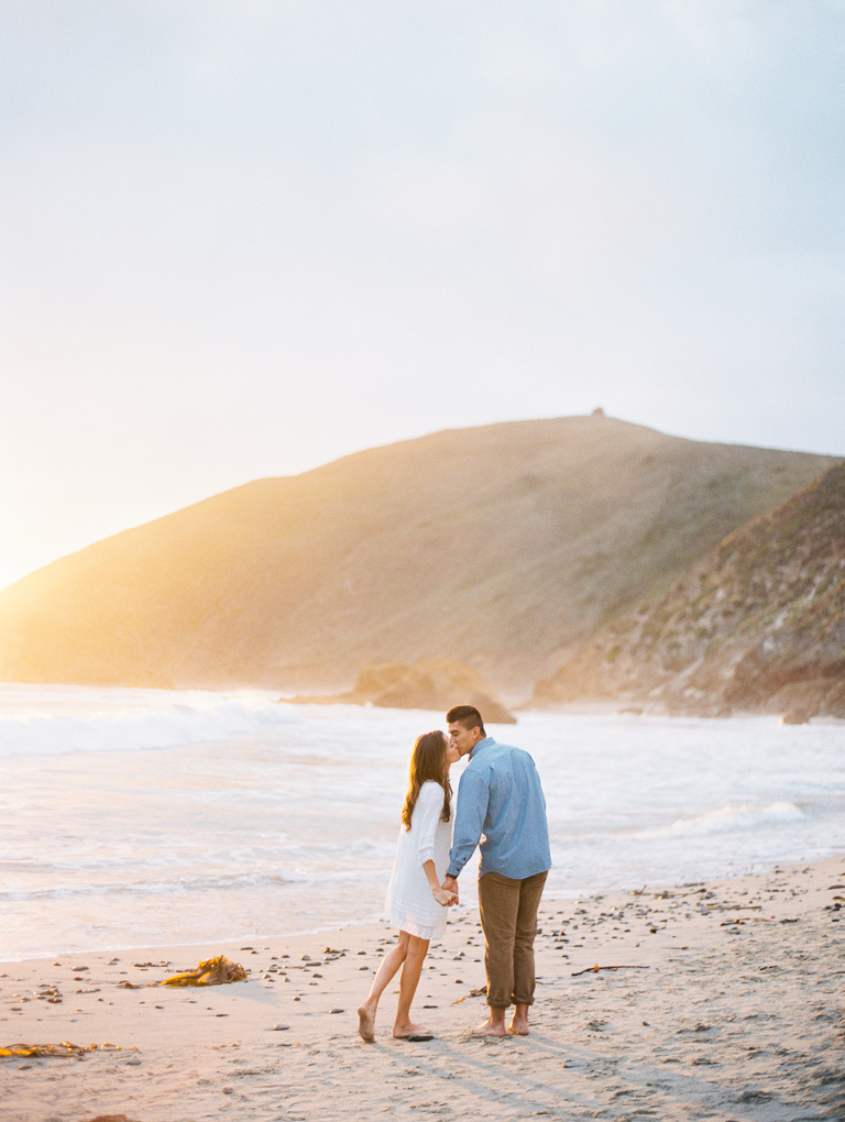 Couple on Pfieffer Beach at sunset in Big Sur