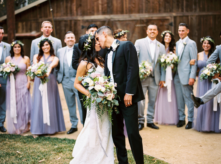 Bride and Groom celebrate with their bridal party